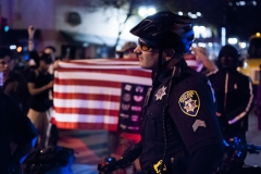 161109-Trump-protest-cop-and-flag-Large