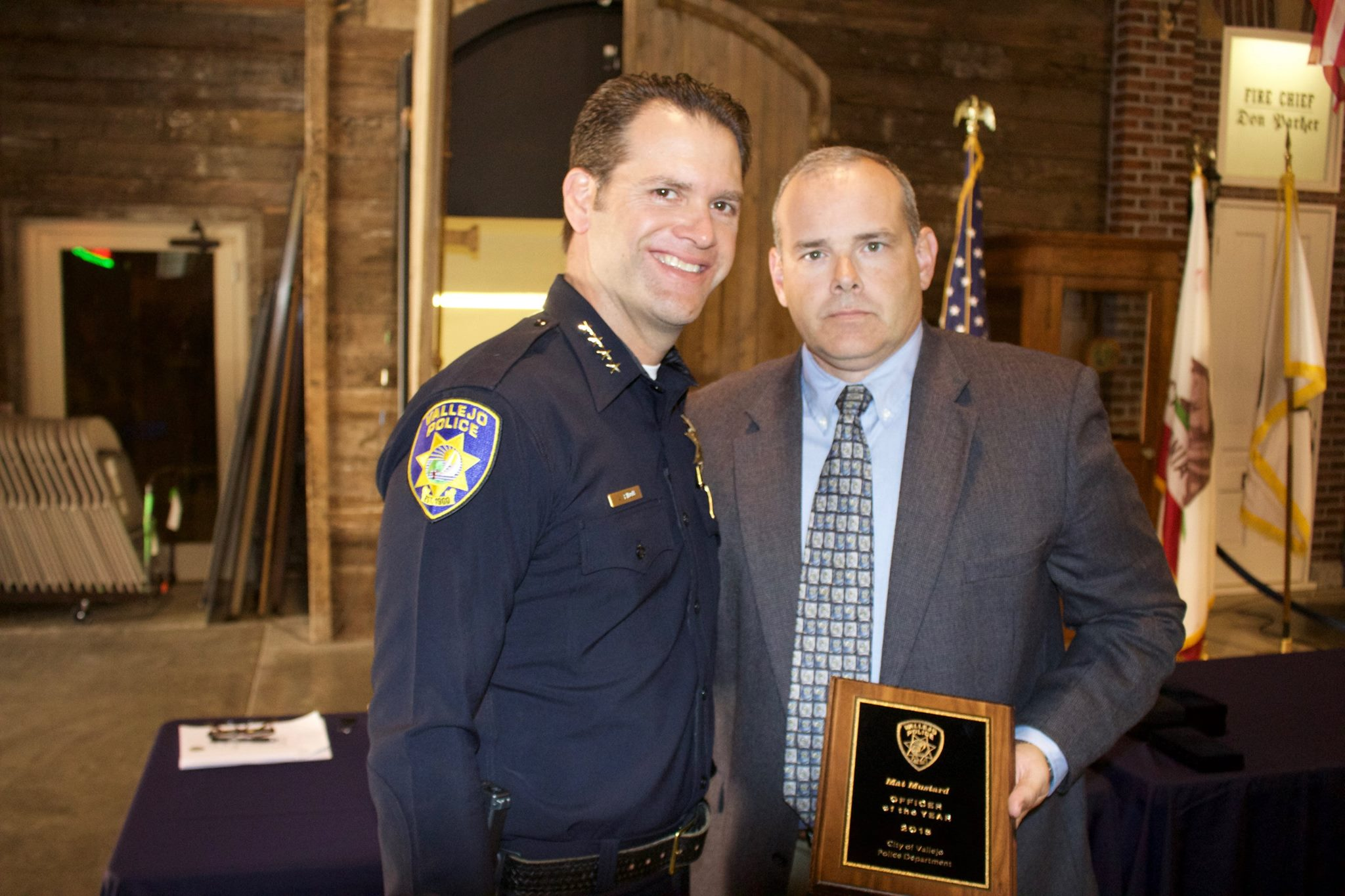 Vallejo police Chief Andrew Bidou, left, presents Detective Mat Mustard with the department's