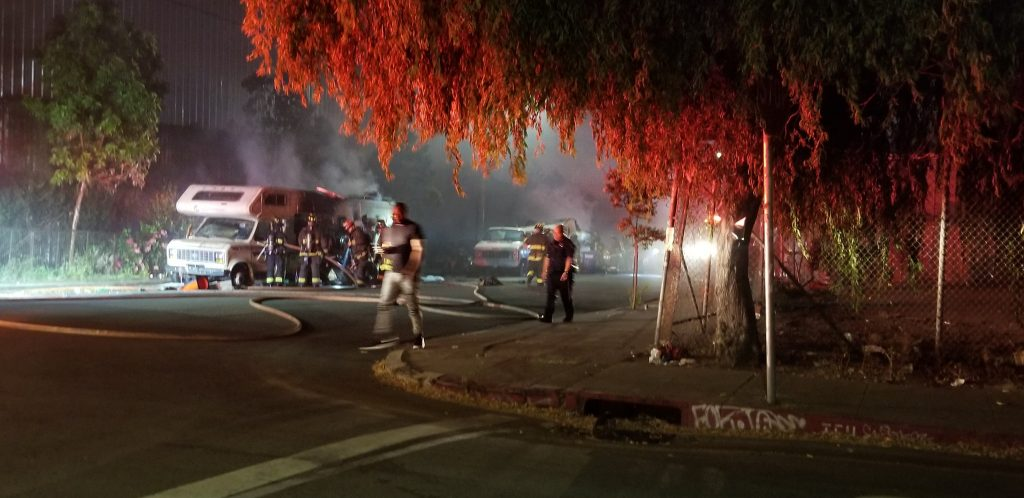 Oakland firefighters extinguish a fire in two RVs reportedly set by masked men in West Oakland on Aug. 2, 2019. Photo courtesy Jessica Brown.