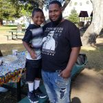 Dujuan Armstrong and his son. Photo courtesy of Barbara Doss.