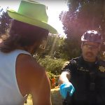 "Officer Sean Aranas confronts Jesse ""Cactus"" Timms in People's Park on May 13."