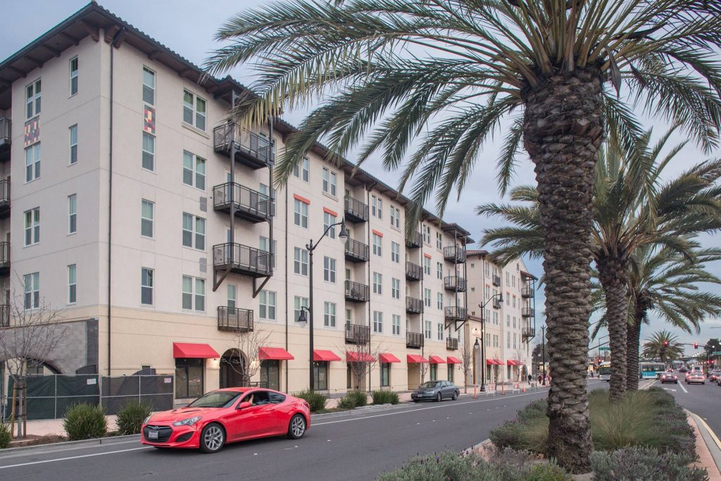 A new 115-unit apartment complex opened at the San Leandro BART station in May 2017. Photo courtesy BRIDGE Housing.
