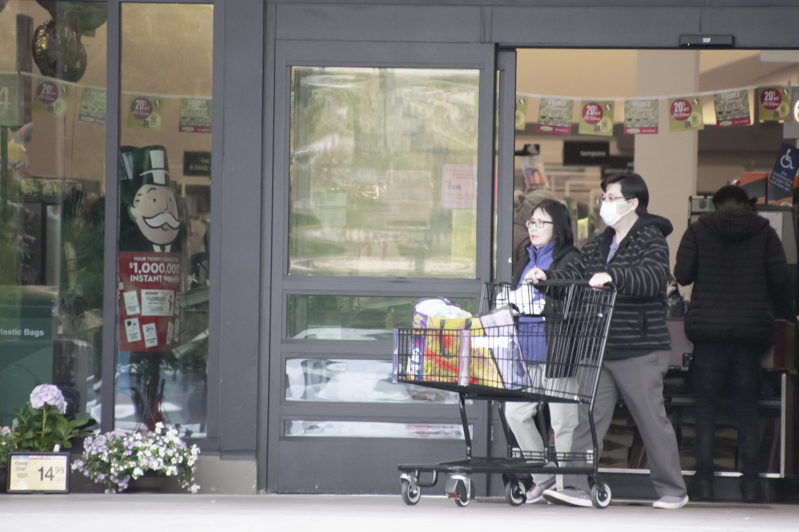 A couple exits a Safeway store in North Oakland on March 23, 2020. Photo by Scott Morris.